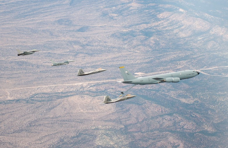 F-22s and F-16s refuel from a KC-136