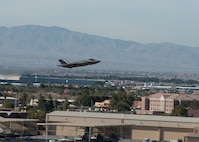 F-35 taking off over buildings