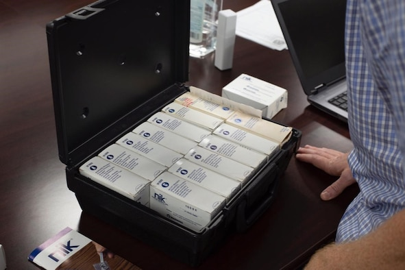 A case of drug test kits is used during a virtual subject matter expert exchange between members of Guam's Department of the Air Force Office of Special Investigations and the Federated States of Micronesia National Police and Pohnpei State Police on Andersen Air Force Base, Guam Nov. 17, 2020. OSI and FSM police shared best practices to promote the success of processing drug related cases throughout the Oceania law enforcement community. (U.S. Air Force photo by Staff Sgt. Nicholas Crisp)