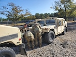 Soldiers with the 95th Civil Affairs Brigade prepare an excess vehicle for turn in at DLA Disposition Services' Fort Bragg site Nov. 10.