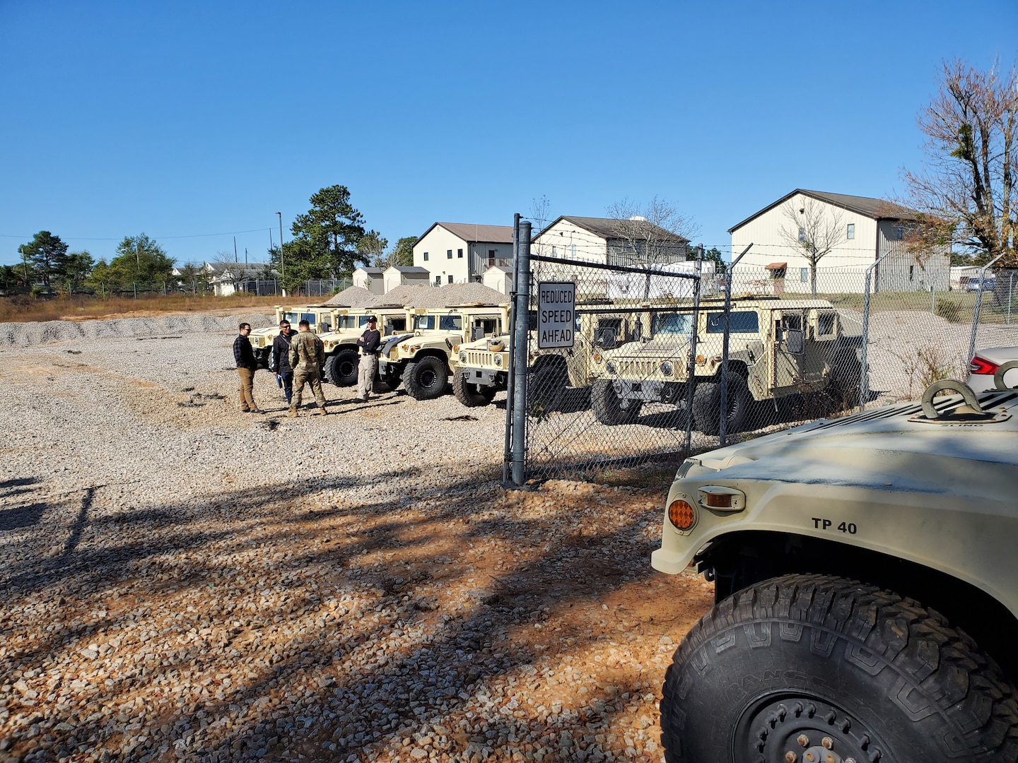DLA Disposition Services personnel welcome members of the 95th Civil Affairs Brigade arriving Nov. 4 at the Fort Bragg site to turn-in excess Humvees.