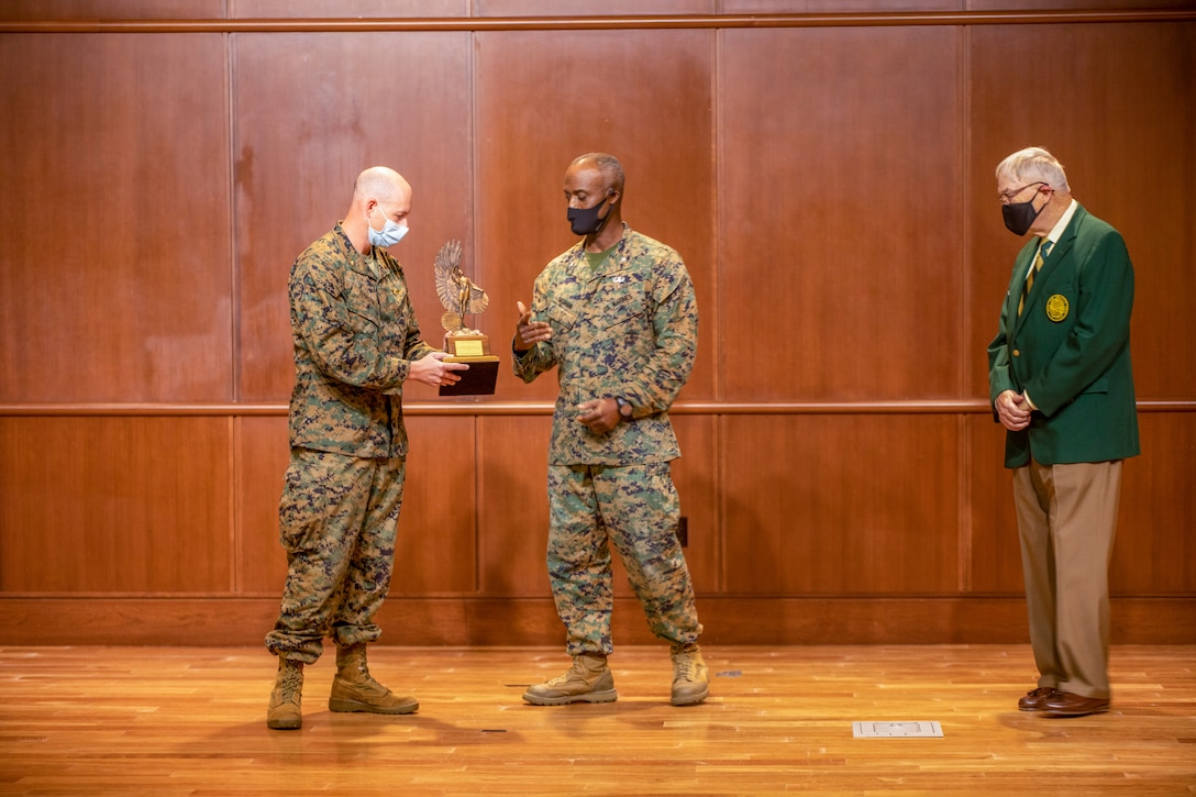 Maj. Jonathan Hansen, 4th Marine Aircraft Wing director of safety and standardization, accepts the Admiral James S. Russell Naval Aviation Flight Safety Award from Col. Gerald Graham, the 4th Marine Aircraft Wing chief of staff, during an award ceremony on Nov. 13, 2020 at Marine Corps Support Facility New Orleans. Pilots with 4th MAW flew more than 20,000 hours with no Class A flight-related or aviation-ground mishaps, which placed it at the top of other competitive commands. (U.S. Marine Corps photo by Lance Cpl. Mitchell Collyer)