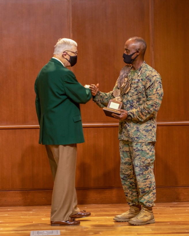 Col. Gerald Graham, the 4th Marine Aircraft Wing chief of staff, accepts the Admiral James S. Russell Naval Aviation Flight Safety Award from Lt. Gen. Nicholas Kehoe, USAF (ret.), the national commander of the Order of the Daedalians, during an award ceremony on Nov. 13, 2020 at Marine Corps Support Facility New Orleans. Pilots with 4th MAW flew more than 20,000 hours with no Class A flight-related or aviation-ground mishaps, which placed it at the top of other competitive commands. (U.S. Marine Corps photo by Lance Cpl. Mitchell Collyer)