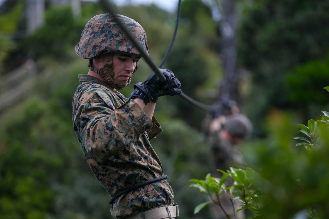 A U.S. Marine negotiates an obstacle at the Jungle Warfare Training Center at Camp Gonsalves, Okinawa, Japan, Nov. 13.