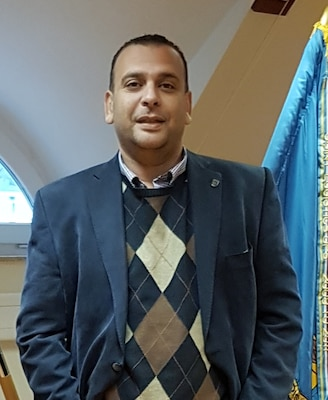 man standing in a suit jacket.