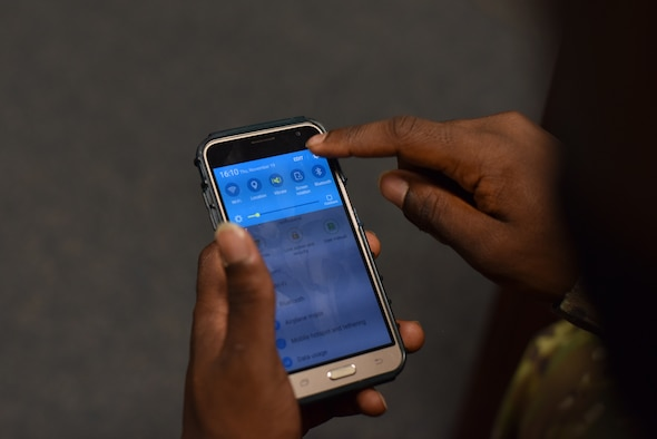 A military member adjusts their settings to receive emergency alerts through their phone Nov. 19, 2020, on Goodfellow Air Force Base, Texas. Adjusting notifications will ensure all notifications are received by the phone user. (U.S. Air Force photo by Staff Sgt. Seraiah Wolf)