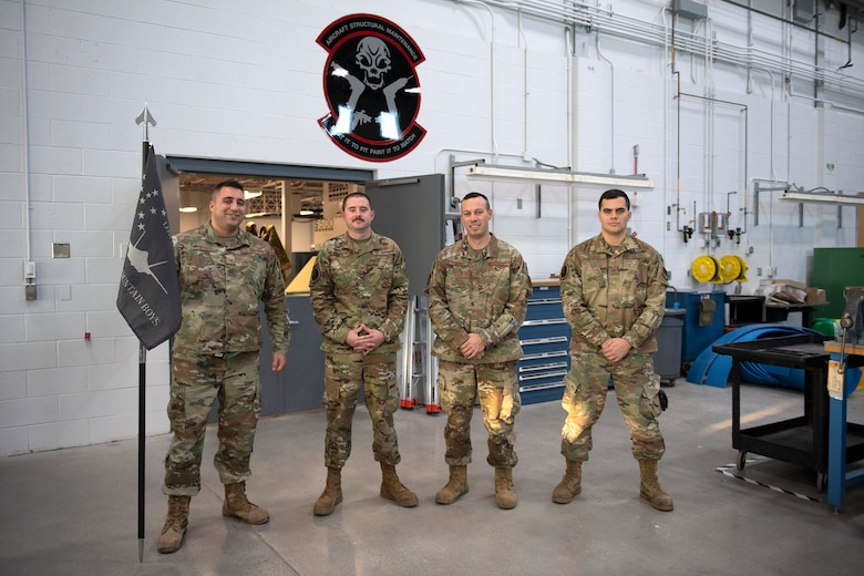 Master Sgt. Dykas, Tech. Sgt. Bohan, Master Sgt. Lamay and Tech Sgt. George, members assigned to the 158th Maintenance Group low observable shop, stand for a group portrait in their new building at the Vermont Air National Guard base.