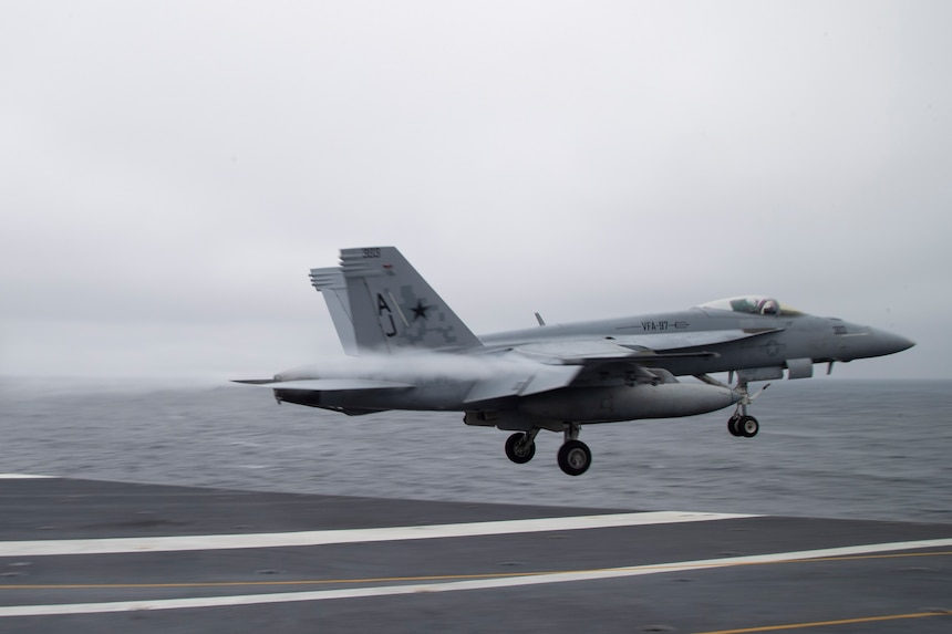 """An F/A-18E Super Hornet attached to the """"Warhawks"""" of Strike Fighter Squadron (VFA) 97, launches from the flight deck of the aircraft carrier USS Gerald R. Ford (CVN 78)., Nov. 13, 2020."""
