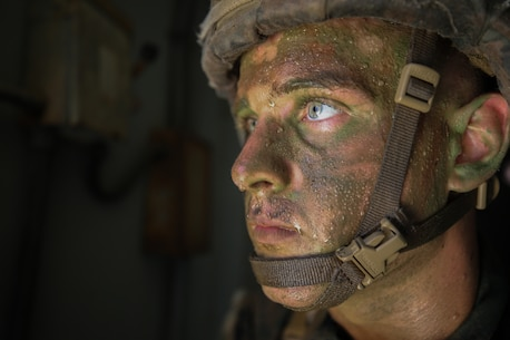 A U.S. Marine with 1st Battalion, 1st Marine Regiment, 1st Marine Division posts security at a window during a Kilo 2 Military Operations in urban terrain (MOUT) evaluation at Marine Corps Base Camp Pendleton, California, Oct. 18, 2020.
