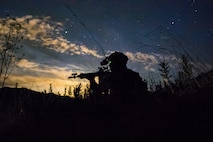 U.S. Marine Lance Cpl. James Esquibel, a rifleman with 3rd Battalion, 4th Marine Regiment, 1st Marine Division scans a road for notional enemies during a Marine Corps Combat Readiness Evaluation (MCCRE) on Marine Corps Base Camp Pendleton, Calif., Aug. 12, 2020