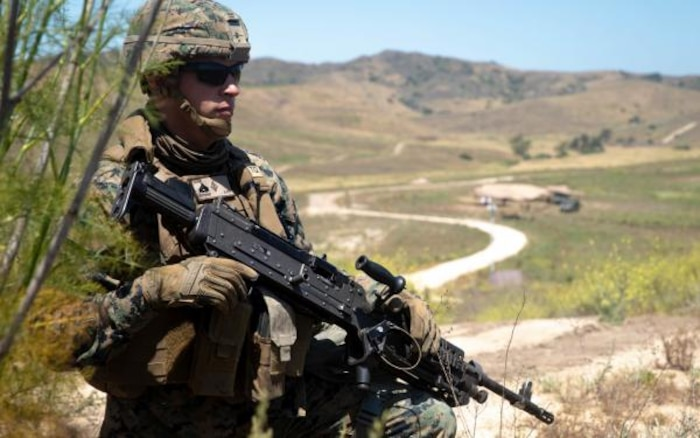 A U.S. Marine with the 1st Marine Division (1st MARDIV) Band conducts a ground patrol exercise at Marine Corps Base Camp Pendleton, California, May 27, 2020.
