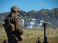 U.S. Marine Corps Pfc. Nathaniel J. Chavez, a mortarman with Weapons Company, 3rd Battalion, 1st Marine Regiment, 1st Marine Division, observes an M252 81mm mortar during a fire support team (FST) training exercise at Marine Corps Base Camp Pendleton, California, April 15, 2020.
