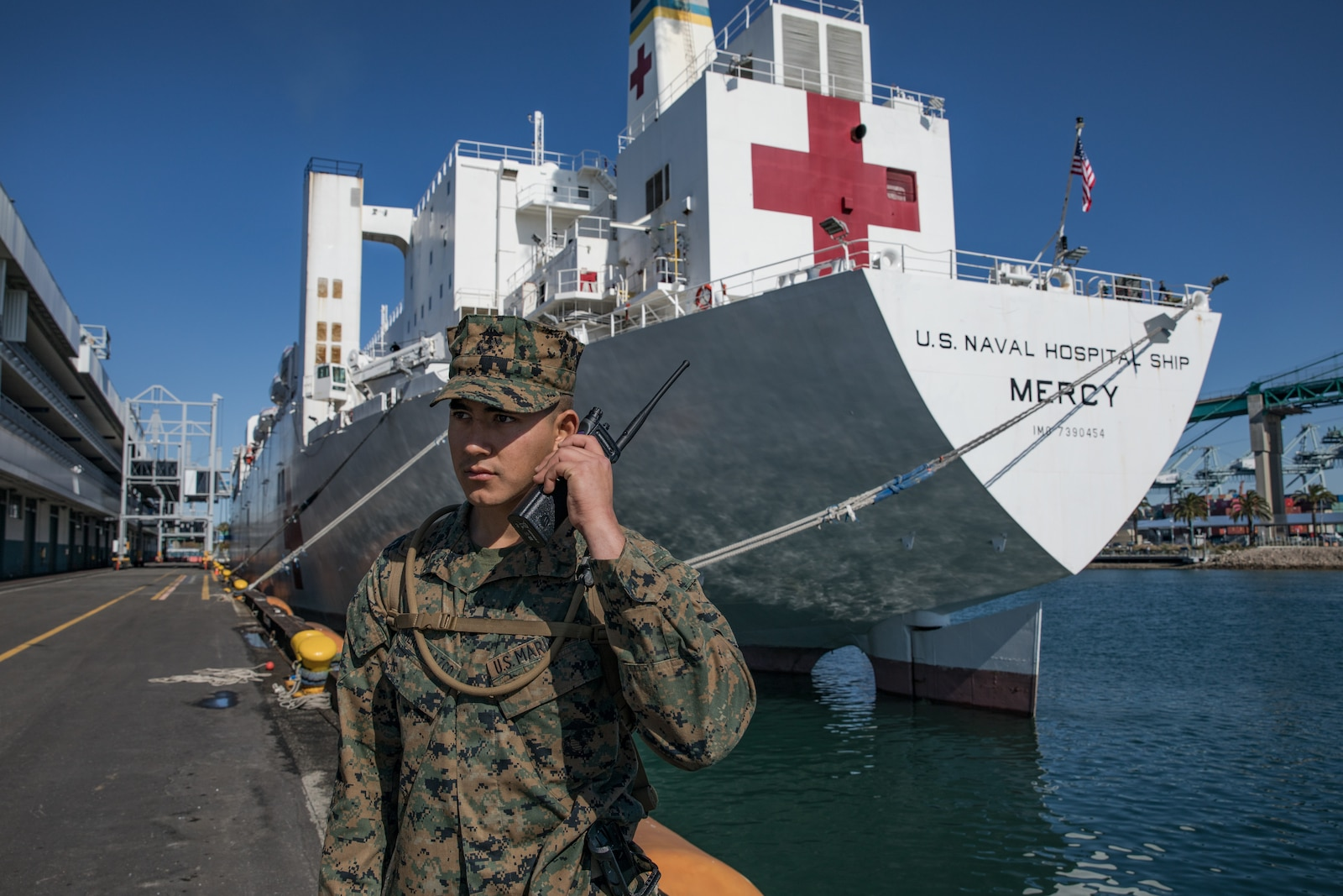 U.S. Marine Corps Pfc. Arnoldo RomeroVelazco, a rifleman with 1st  Battalion, 4th Marine Regiment, 1st Marine Division, posts security to secure the Military Sealift Command hospital ship USNS Mercy (T-AH 19) in Los Angeles, California, March 27.