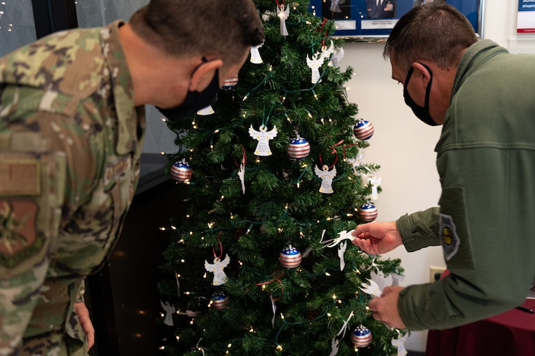 A photo of Airmen looking for ornaments on a tree