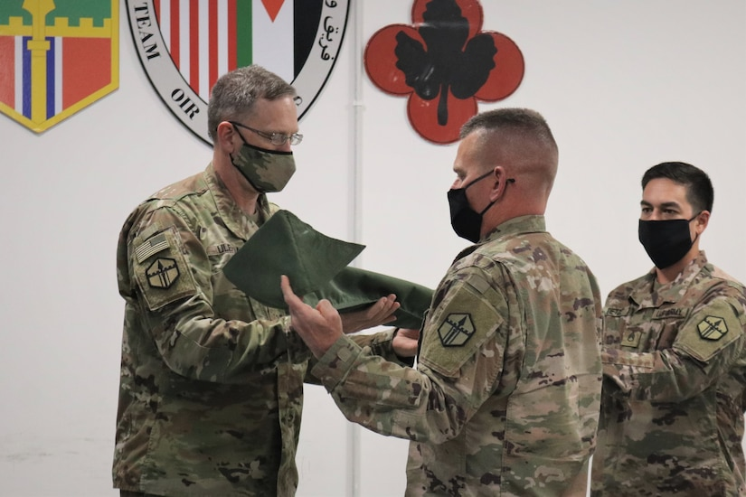 Col. Derek Ulehla and Command Sgt. Maj. James Marsh case the 301st Maneuver Enhancement Brigade colors after the transfer of authority ceremony for Area Support Group-Jordan. The 301st MEB mobilized to Jordan in March to provide support operations for U.S. forces in Jordan. The U.S. military is in Jordan to partner with the Jordan Armed Forces to meet common security objectives in the region.