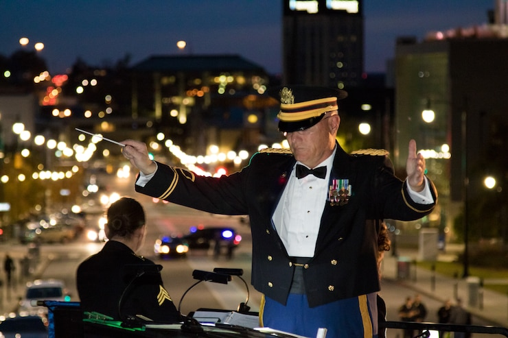 Chief Warrant Officer 4 Mark Mills leads the 151st Alabama National Guard Band at the Capital Christmas Tree Lighting Ceremony at the Sate Capita
