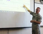 Chief Master Sgt. Shawn Peno instructing members of the New York Guard, the state's defense force, on the use of the computer communications system used by the New York National Guard during disasters, at Camp Smith Training Site on June 24, 2017.