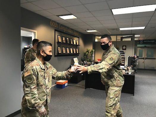Male service members in an office building.