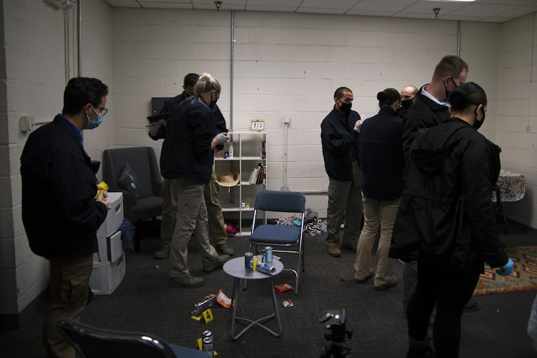 U.S. Air Force Office of Special Investigations agents and Security Forces Office of Investigations agents process the mock crime scene during training at Joint Base Andrews, Md., Oct. 30, 2020. Evidence is a key component of building a case.