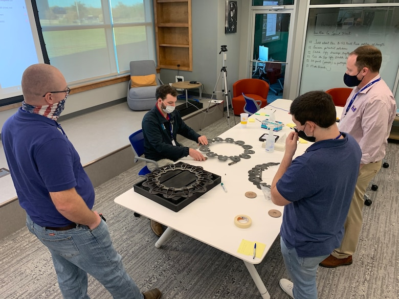 Airmen and academia partners from Louisiana Tech University and LSU Shreveport work on refining the prototype design to solve drilling of B-52 brakes during a Design Sprint held at STRIKEWERX in Bossier City, La., Nov. 16-19, 2020.