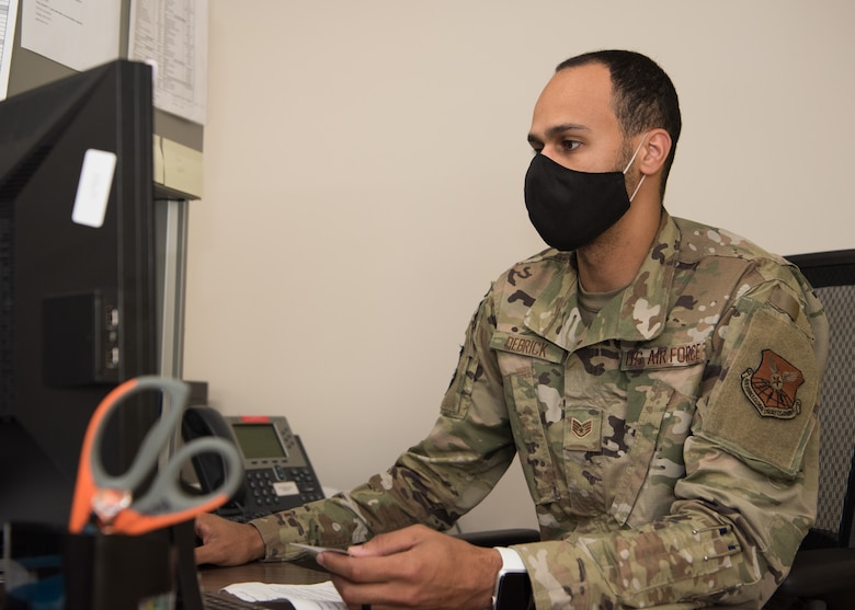 U.S. Air Force Staff Sgt. Bradley Debrick, 509th Medical Operations Squadron immunizations technician, works on his computer in the immunizations clinic.