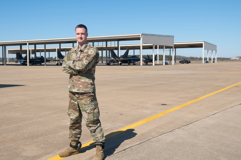 Capt. Andrew Gibler poses for a photo on the flightline on March 8, 2020, at Joint Base Langley-Eustis, Virginia. He has applied his experience and passion for mechanics to his job as a maintenance officer in the 192nd Aircraft Maintenance Squadron.