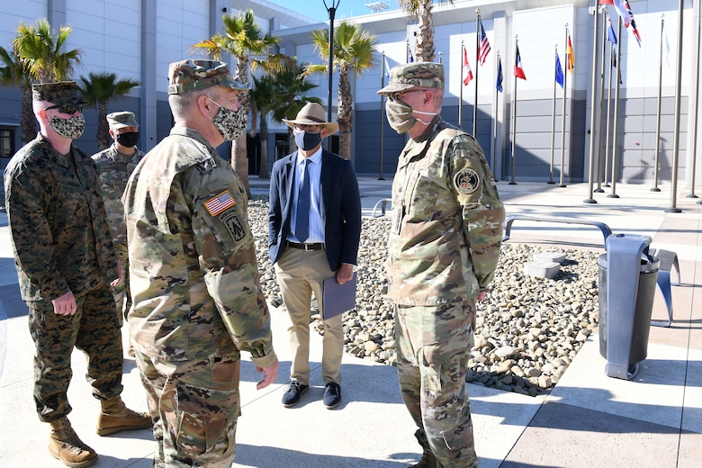 """U.S. Army Gen. James H. Dickinson, United States Space Command commander, """"coins"""" Lt. Col. Kevin Tobias, Combined Space Operations Center consolidation director, Nov. 16, 2020, at Vandenberg Air Force Base, Calif."""