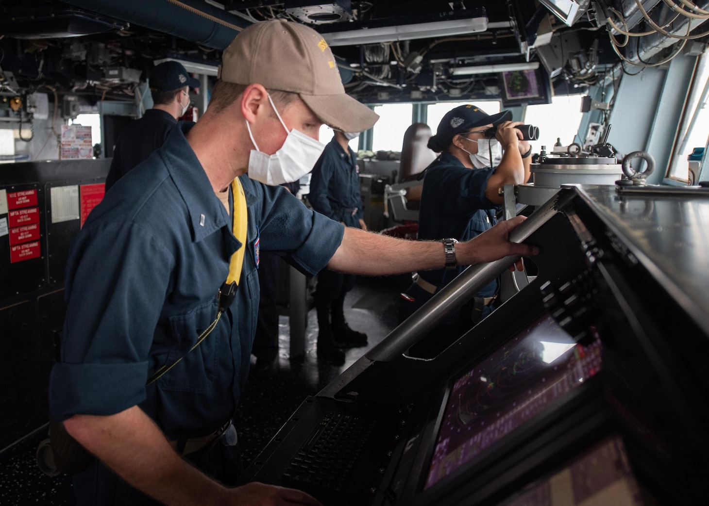 TAIWAN STRAIT (Nov. 20, 2020) – Lt. j. g. Benjamin Pershall, from Annapolis, Md., uses the Automated Radar Plotting Aid (ARPA) on the bridge of the guided-missile destroyer USS Barry (DDG 62) as the ship conducts routine underway operations in the Taiwan Strait. Barry is assigned to Destroyer Squadron (DESRON) 15, the Navy's largest forward-deployed DESRON and the U.S. 7th Fleet's principal surface force, forward-deployed to the U.S. 7th Fleet area of operations in support of a free and open Indo-Pacific. (U.S. Navy photo by Mass Communication Specialist Seaman Molly Crawford)