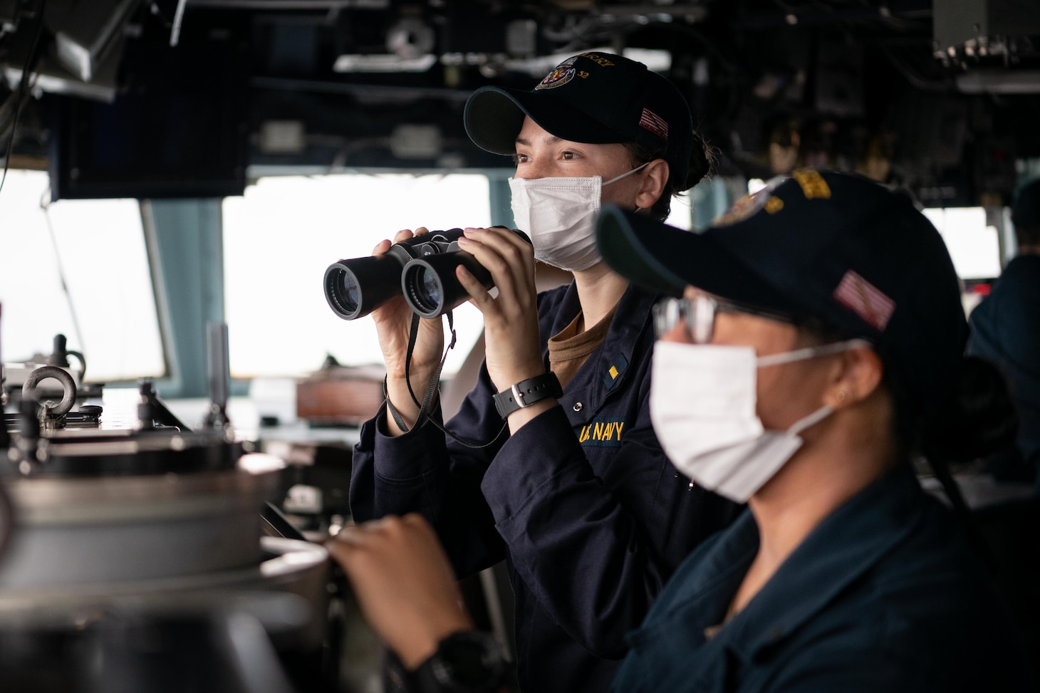TAIWAN STRAIT (Nov. 20, 2020) – Ensign Antonia Vinci, from St. Petersburg, Fla., scans the horizon for contacts on the bridge of the guided-missile destroyer USS Barry (DDG 62) as the ship conducts routine underway operations in the Taiwan Strait. Barry is assigned to Destroyer Squadron (DESRON) 15, the Navy's largest forward-deployed DESRON and the U.S. 7th Fleet's principal surface force, forward-deployed to the U.S. 7th Fleet area of operations in support of a free and open Indo-Pacific. (U.S. Navy photo by Lieutenant Junior Grade Samuel Hardgrove)