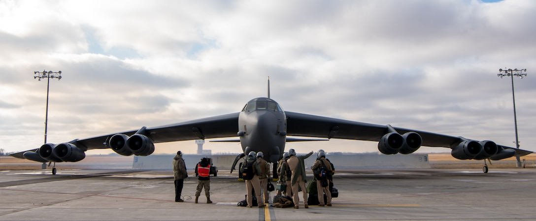 Aircrew prepare to board a B-52H Stratofortress on the flightline on Nov. 20, 2020, at Minot Air Force Base, North Dakota. U.S. Central Command is commmited to preserving and protecting the freedom of navigation and the free flow of commerce throughout the region. While the United continues to have robust defensive capapbilities throughout the U.S. Central Command area of responsibility, any potential adversary should understand that no nation on earth is more ready and capable of rapidly deploying additional combat power in the face of any aggression. (U.S. Air Force photo by Airman 1st Class Jesse Jenny)