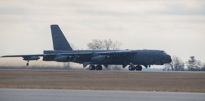A B-52H Stratofortress takes off from  the flightline on Nov. 20, 2020, at Minot Air Force Base, North Dakota. U.S. Central Command is commmited to preserving and protecting the freedom of navigation and the free flow of commerce throughout the region. While the United continues to have robust defensive capapbilities throughout the U.S. Central Command area of responsibility, any potential adversary should understand that no nation on earth is more ready and capable of rapidly deploying additional combat power in the face of any aggression. (U.S. Air Force photo by Airman 1st Class Jesse Jenny)