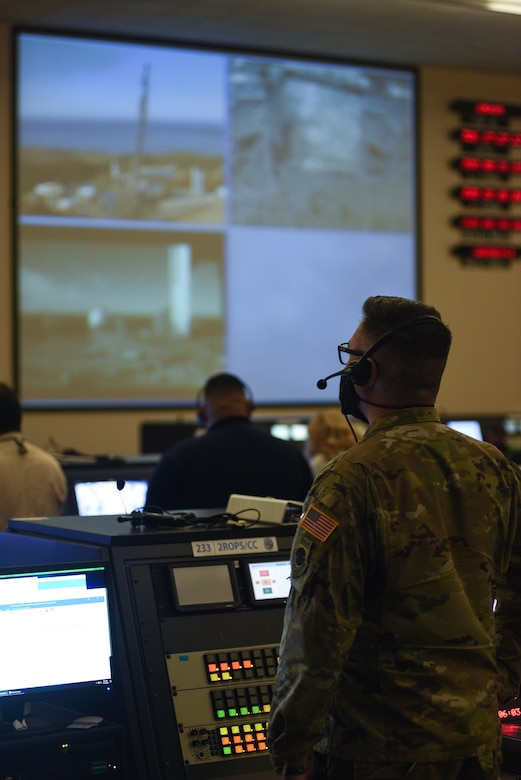 Photo of airman at launch console
