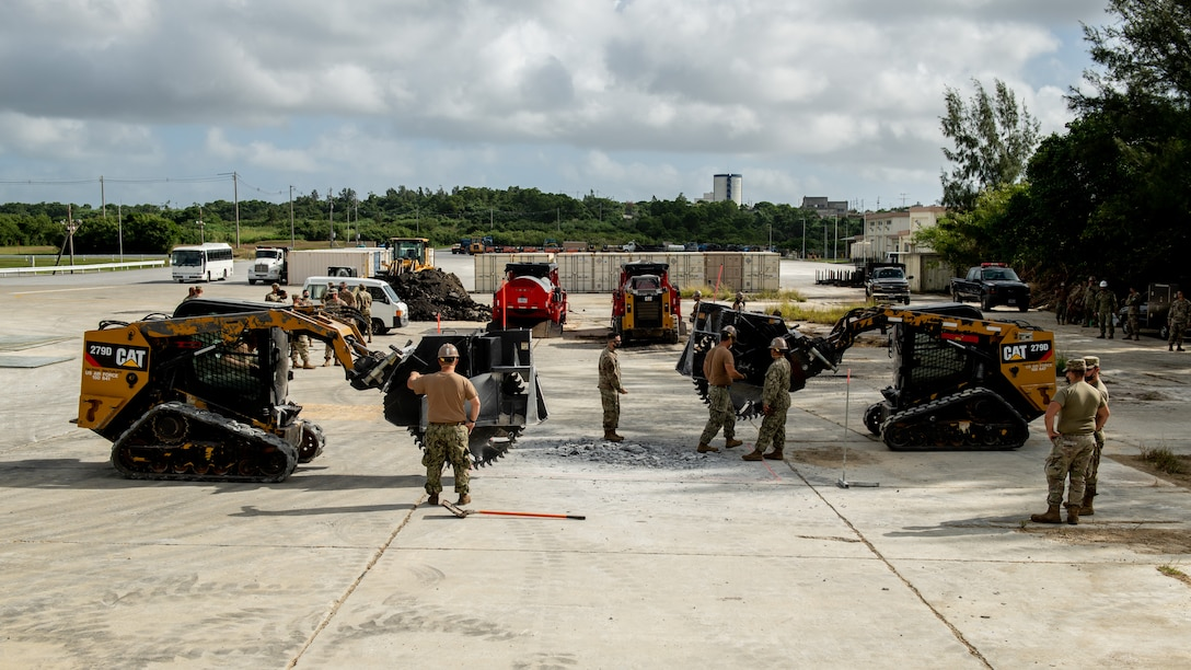 U.S. Air Force 18th Civil Engineer Squadron Airmen and Navy Mobile Construction Battalion 3 Seabees conduct a rapid airfield damage repair exercise Nov. 18, 2020, at Kadena Air Base, Japan. Units throughout the U.S. Indo-Pacific Command theater conduct regular joint training in order to strengthen partnerships and interoperability. (U.S. Air Force photo by Staff Sgt. Peter Reft)