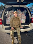 Senior Airman Alexis Maher, 103rd Security Forces Squadron defender, packs a vehicle with Thanksgiving meal kits at Bradley Air National Guard Base in East Granby, Connecticut, Nov. 16, 2020. Maher organized the squadron's second annual Thanksgiving food drive, in which 103rd Airlift Wing members helped donate 120 family meal kits to food banks in six towns.