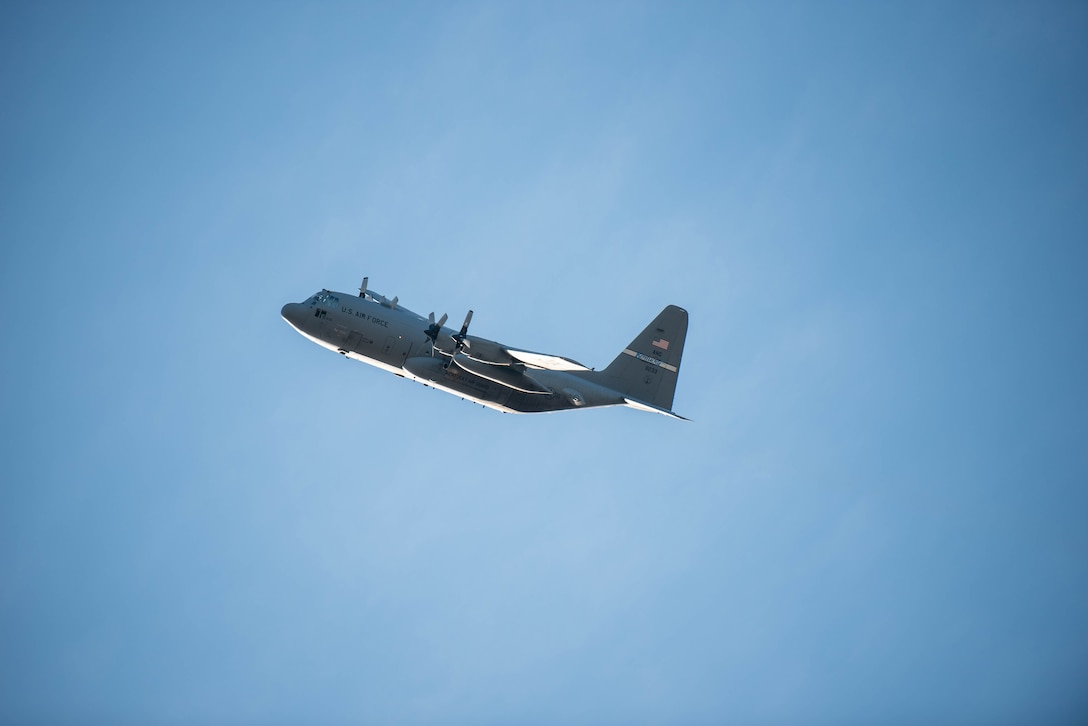A C-130 Hercules from the 123rd Airlift Wing flies over the Kentucky Air National Guard base as more than 90 Airmen from the unit return home to Louisville, Ky., Nov. 18, 2020, after completing a four-month deployment to the Middle East in support of Operations Inherent Resolve and Freedom's Sentinel. The Airmen operated from an undisclosed air base while flying troops and cargo across the U.S. Central Command Area of Responsibility. (U.S. Air National Guard photo by Phil Speck)