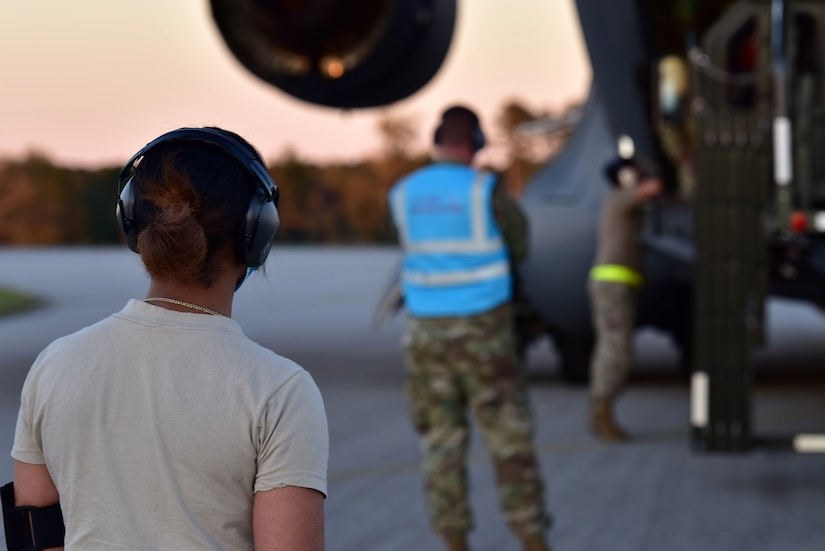 Airmen assigned to the 628th Air Base Wing begin to offload cargo from a C-17 Globemaster III at McEntire Joint National Guard Base, S.C., Nov. 16, 2020. Palmetto Challenge is a global mobilization exercise held at McEntire Joint National Guard Base, S.C. The exercise is held in order to develop readiness and awareness in a simulated deployed environment for over 100 Airmen from Joint Base Charleston.