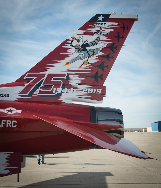 The 75th anniversary tail art commemorating the years and dedication of the men and women of the 301st Fighter Wing. This F-16 arrived fully dressed to U.S. Naval Air Station Joint Reserve Base Fort Worth, Texas on November 4, 2020. (U.S. Air Force photo by Jeremy Roman)