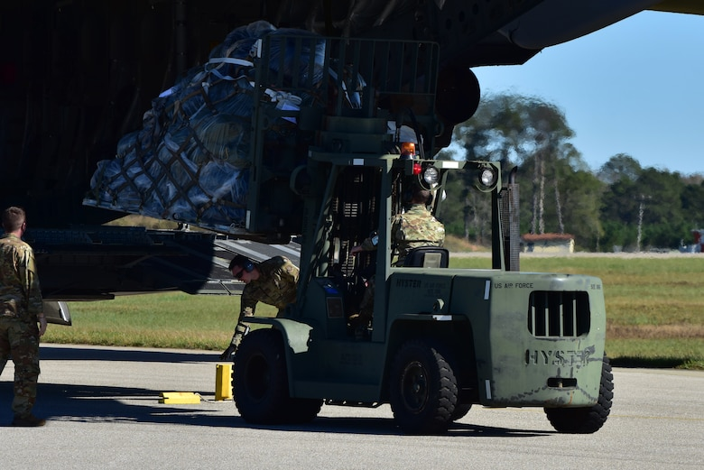 Airmen assigned to the 628th Air Base Wing begin to offload cargo from a C-17 Globemaster III at McEntire Joint National Guard Base, S.C., Nov. 16, 2020. Palmetto Challenge is a global mobilization exercise held at McEntire Joint National Guard Base, S.C., and Pope Army Airfield, N.C. The exercise is held in order to develop readiness and awareness in a simulated deployed environment for over 100 Airmen from Joint Base Charleston.