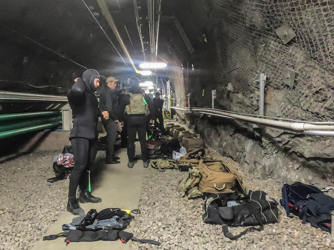 SFOD (A) members prepare to dive into a water reservoir inside Cheyenne Mountain
