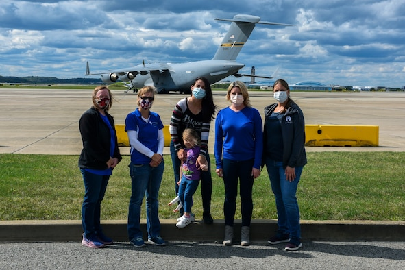 Members of the 911th Airlift Wing Key Spouse Group pose for a photo during a base tour at the Pittsburgh International Airport Air Reserve Station, Pennsylvania, Oct. 4, 2020.