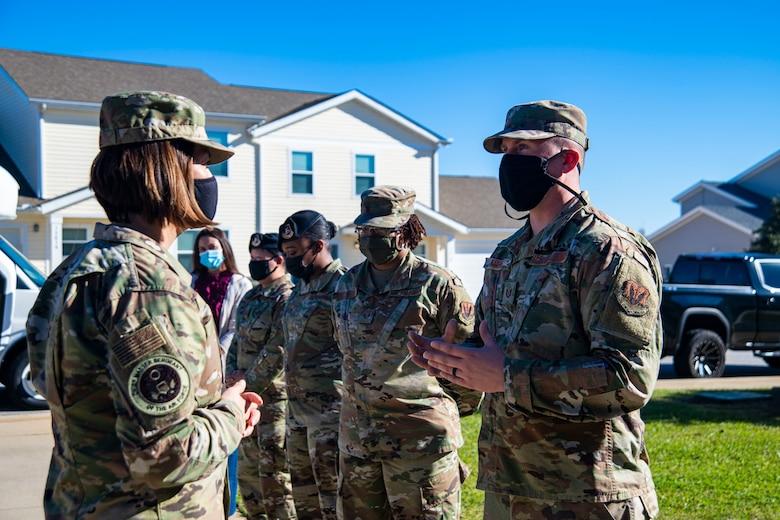 A photo of Airmen having a conversation.