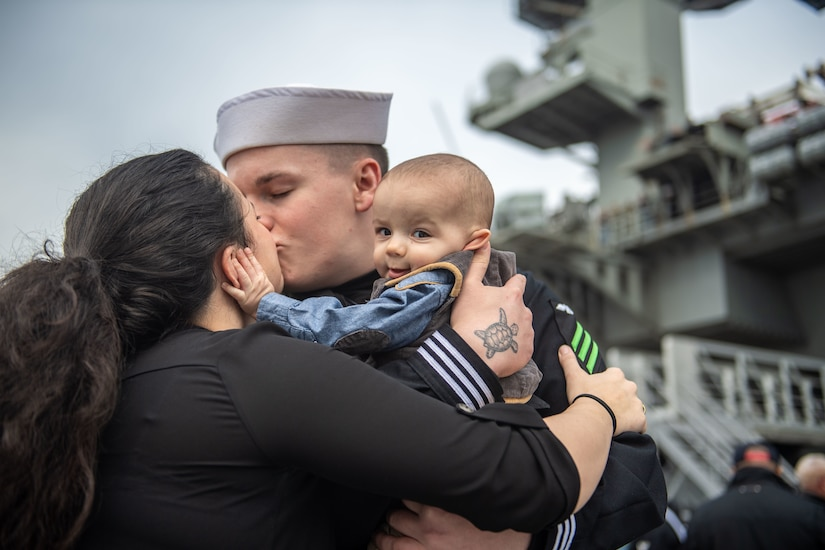 Family embracing during homecoming