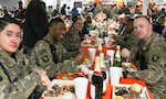 Soldiers at Bagram Airfield in Afghanistan enjoy Thanksgiving dinner in a file photo from 2018. While this year's Thanksgiving meal may look different this year, the Defense Logistics Agency Troop Support has been providing traditional Thanksgiving food to field kitchens, dining facilities and galleys to locations in the United States and around the world. (Photo by SSG Caitlyn Byrne)