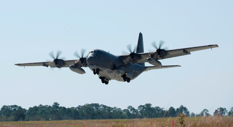 Large military aircraft coming in for a landing