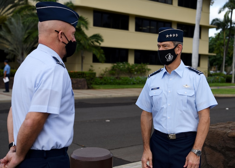 "U.S. Space Force Gen. John W. ""Jay"" Raymond, left, Chief of Space Operations, speaks to U.S. Air Force Gen. Ken Wilsbach, Pacific Air Forces commander, during his first official visit to Pacific Air Forces Headquarters at Joint Base Pearl Harbor-Hickam, Hawaii, Nov. 19, 2020. The visit allowed Raymond to discuss the Space Force's foundational direction and the importance of interoperability with allies and partners in the Indo-Pacific region. (U.S. Air Force photo by Tech. Sgt. Zach Vaughn)"