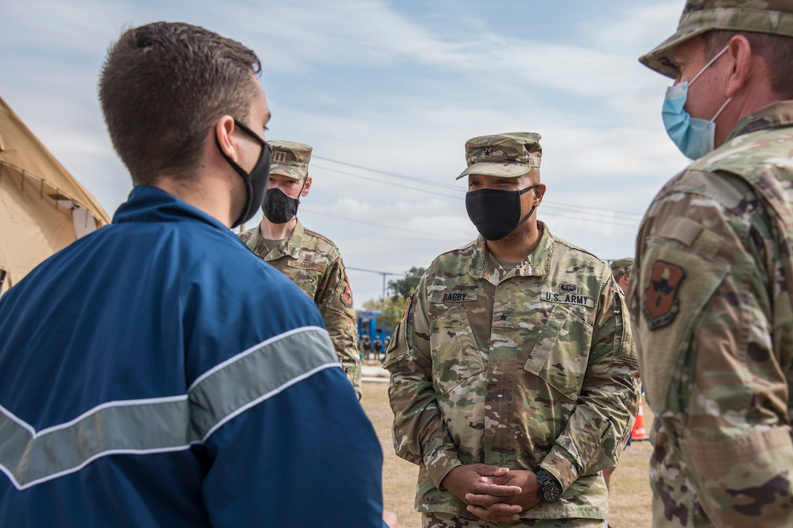 U.S. Army Brig. Gen. Shan K. Bagby, Brooke Army Medical Center commanding general, listens to a brief about the COVID-19 tent operations at the Reid Health Services Center, Nov. 23, 2020, on Joint Base San Antonio-Lackland, Texas.