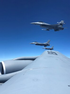 Three F-16 Fighting Falcon aircraft assigned to Homestead Air Reserve Base, Fla., fly in formation alongside the  wing of a KC-135 Stratotanker from MacDill Air Force Base, Fla., prior to an in-flight refueling, Apr. 15, 2019.