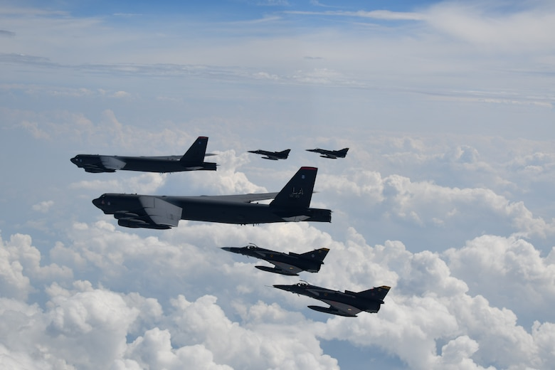 U.S. aircraft and Colombian aircraft flying in formation