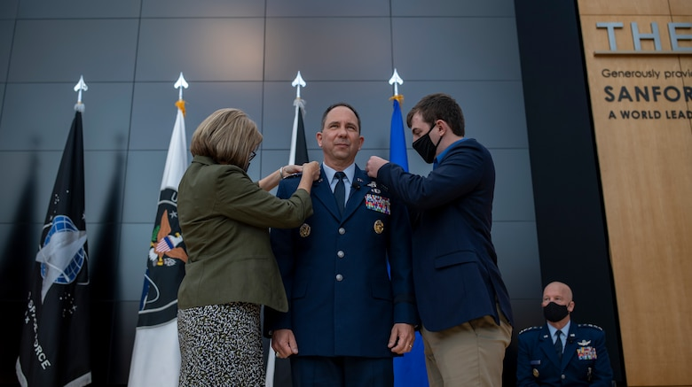 Tonia Shaw (left) and her son, Timothy Shaw (right), pin newly promoted U.S. Space Force Lt. Gen. John Shaw during the general's promotion and transfer ceremony Nov. 23, 2020, at the U.S. Air Force Academy in Colorado Springs, Colo.