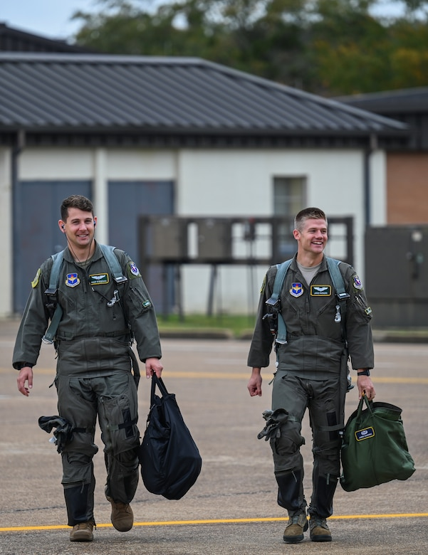 U.S. Air Force Capt. Cole Stegeman (left), 49th Fighter Training Squadron instructor pilot, and 1st Lt. Jared Rackers, 49th FTS Introduction to Fighter Fundamentals graduate, walk towards a T-38 Talon Nov. 11, 2020, on Columbus Air Force Base, Miss. Stegeman and Rackers are both assigned to the same type of aircraft, the F-15 Eagle. (U.S. Air Force photo by Airman 1st Class Davis Donaldson)